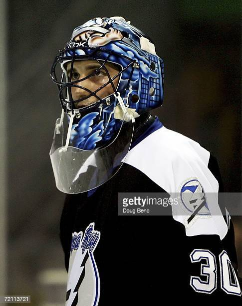 Goaltender Marc Denis of the Tampa Bay Lightning looks toward the bench after giving up the second of two first period goals against the Boston...