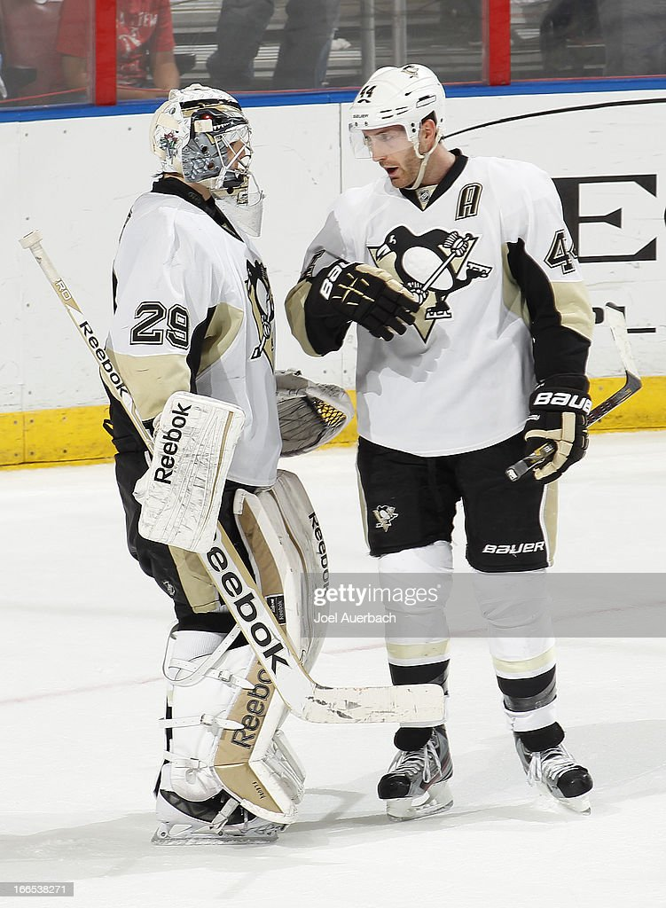 Goaltender <a gi-track='captionPersonalityLinkClicked' href=/galleries/search?phrase=Marc-Andre+Fleury&family=editorial&specificpeople=233779 ng-click='$event.stopPropagation()'>Marc-Andre Fleury</a> #29 is congratulated by <a gi-track='captionPersonalityLinkClicked' href=/galleries/search?phrase=Brooks+Orpik&family=editorial&specificpeople=213074 ng-click='$event.stopPropagation()'>Brooks Orpik</a> #44 of the Pittsburgh Penguins at the conclusion of the game against the Florida Panthers at the BB&T Center on April 13, 2013 in Sunrise, Florida. The Penguins defeated the Panthers 3-1.
