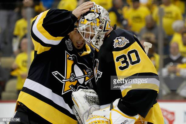 Goaltender MarcAndre Fleury of the Pittsburgh Penguins congratulates goaltender Matt Murray after they defeated the Nashville Predators 41 in Game...