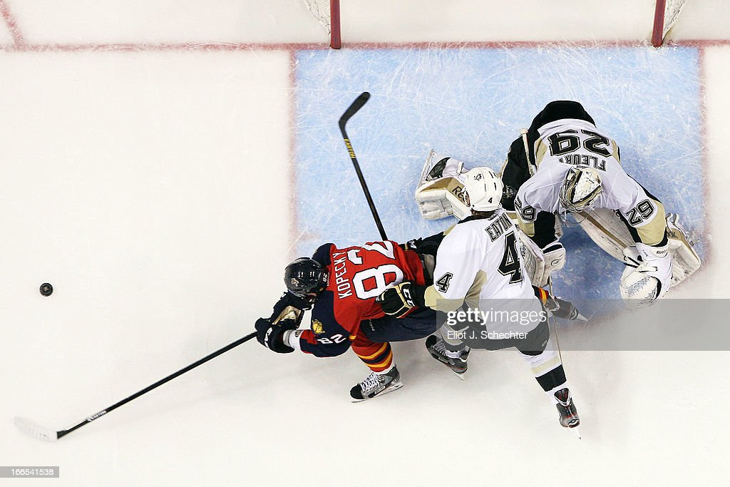 Goaltender <a gi-track='captionPersonalityLinkClicked' href=/galleries/search?phrase=Marc-Andre+Fleury&family=editorial&specificpeople=233779 ng-click='$event.stopPropagation()'>Marc-Andre Fleury</a> #29 of the Pittsburgh Penguins defends the net with the help of teammate Mark Eaton #4 against <a gi-track='captionPersonalityLinkClicked' href=/galleries/search?phrase=Tomas+Kopecky&family=editorial&specificpeople=2234349 ng-click='$event.stopPropagation()'>Tomas Kopecky</a> #82 of the Florida Panthers at the BB&T Center on April 13, 2013 in Sunrise, Florida.