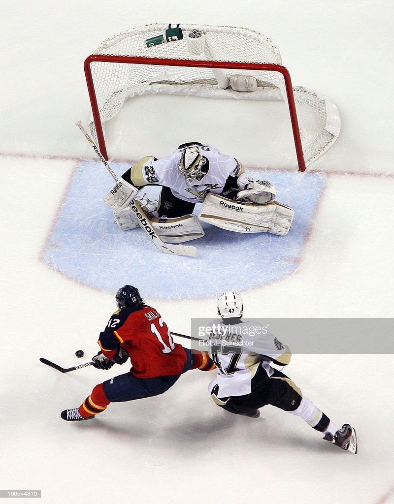 Goaltender Marc-Andre Fleury #29 of the Pittsburgh Penguins defends the net with the help of teammate Simon Despres #47 against <a gi-track='captionPersonalityLinkClicked' href=/galleries/search?phrase=Jack+Skille&family=editorial&specificpeople=697014 ng-click='$event.stopPropagation()'>Jack Skille</a> #12 of the Florida Panthers at the BB&T Center on April 13, 2013 in Sunrise, Florida.