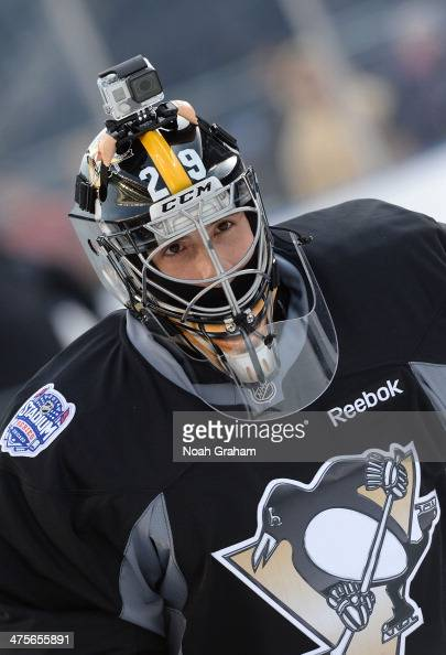 Goaltender MarcAndre Fleury of the Pittsburgh Penguins skates on the ice during the 2014 NHL Stadium Series practice day at Soldier Field on February...