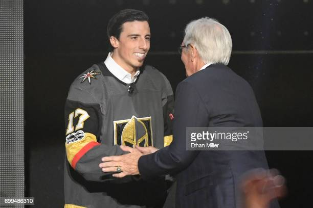 Goaltender MarcAndre Fleury shakes hands with majority owner Bill Foley of the Vegas Golden Knights after Fleury is taken by the Golden Knights in...