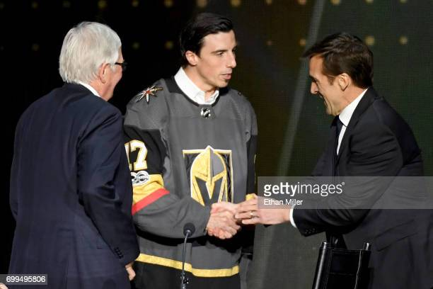 Goaltender MarcAndre Fleury talks with general manager George McPhee after Fleury is taken by the Vegas Golden Knights in the expansion draft during...