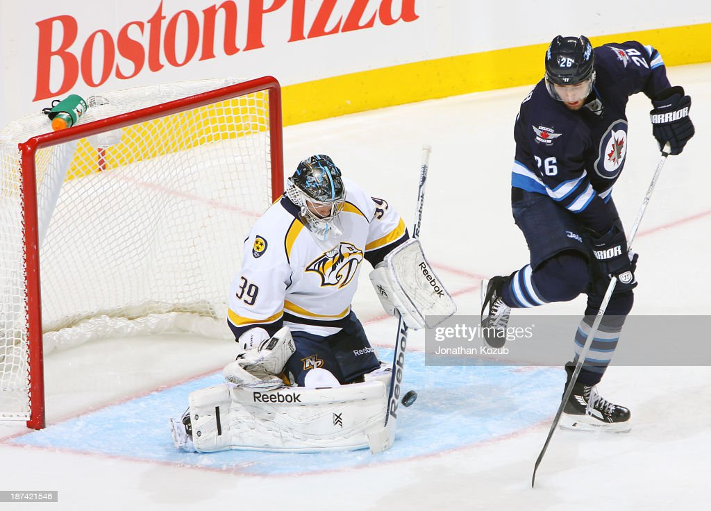 Goaltender Marek Mazanec #39 of the Nashville Predators makes a save as <a gi-track='captionPersonalityLinkClicked' href=/galleries/search?phrase=Blake+Wheeler&family=editorial&specificpeople=716703 ng-click='$event.stopPropagation()'>Blake Wheeler</a> #26 of the Winnipeg Jets provides a screen during second period action at the MTS Centre on November 8, 2013 in Winnipeg, Manitoba, Canada.