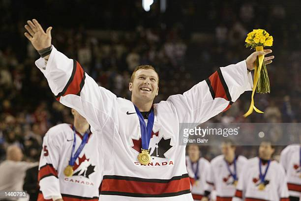 Goaltender Martin Brodeur of Canada smiles as he skates with his gold medal around his neck after the game against the USA in the men's ice hockey...