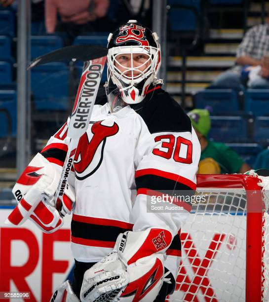 Goaltender Martin Brodeur of the New Jersey Devils adjust his stick during a break in the action against the Tampa Bay Lightning at the St Pete Times...