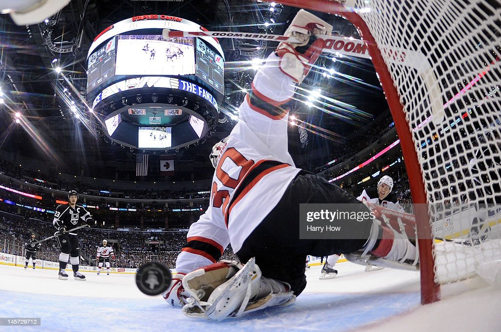 Goaltender <a gi-track='captionPersonalityLinkClicked' href=/galleries/search?phrase=Martin+Brodeur&family=editorial&specificpeople=201594 ng-click='$event.stopPropagation()'>Martin Brodeur</a> #30 of the New Jersey Devils can't make the save on a shot for a goal by <a gi-track='captionPersonalityLinkClicked' href=/galleries/search?phrase=Anze+Kopitar&family=editorial&specificpeople=634911 ng-click='$event.stopPropagation()'>Anze Kopitar</a> #11 of the Los Angeles Kings in the second period of Game Three of the 2012 Stanley Cup Final at Staples Center on June 4, 2012 in Los Angeles, California.