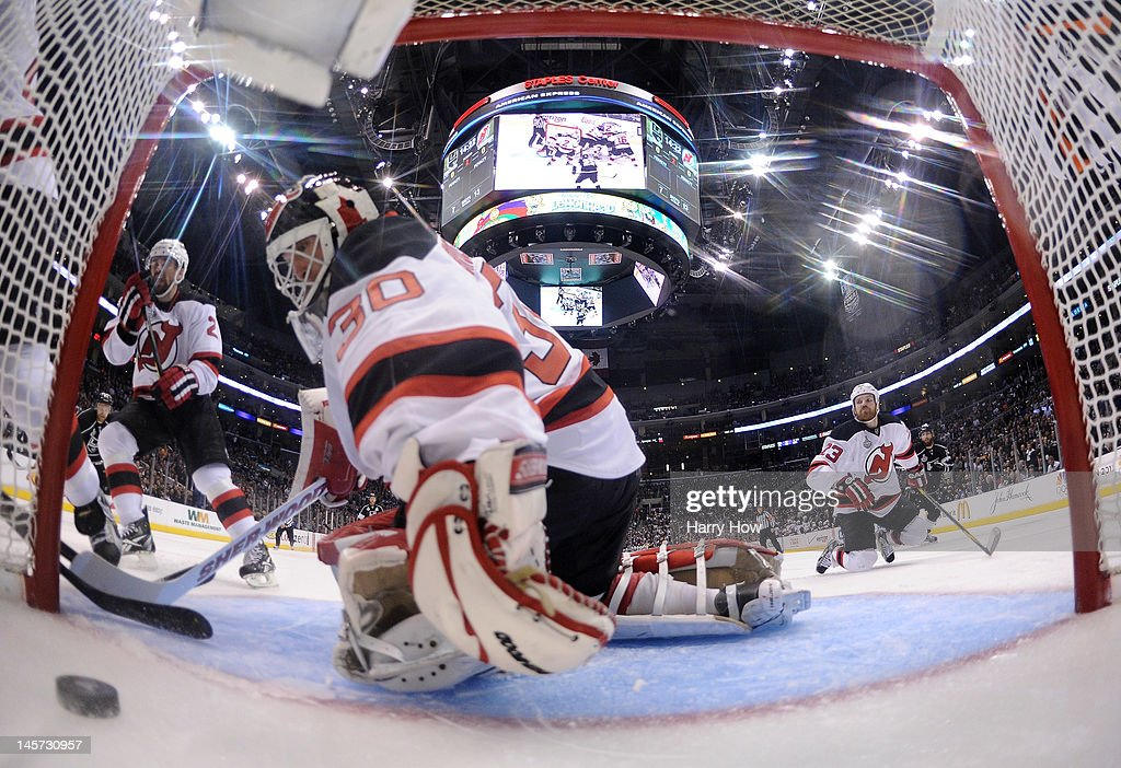 Goaltender <a gi-track='captionPersonalityLinkClicked' href=/galleries/search?phrase=Martin+Brodeur&family=editorial&specificpeople=201594 ng-click='$event.stopPropagation()'>Martin Brodeur</a> #30 of the New Jersey Devils can't stop the puck from going into the net for a goal in the second period of Game Three of the 2012 Stanley Cup Final against the Los Angeles Kings at Staples Center on June 4, 2012 in Los Angeles, California. Alec Martinez #27 of the Los Angeles Kings was credited with the goal.