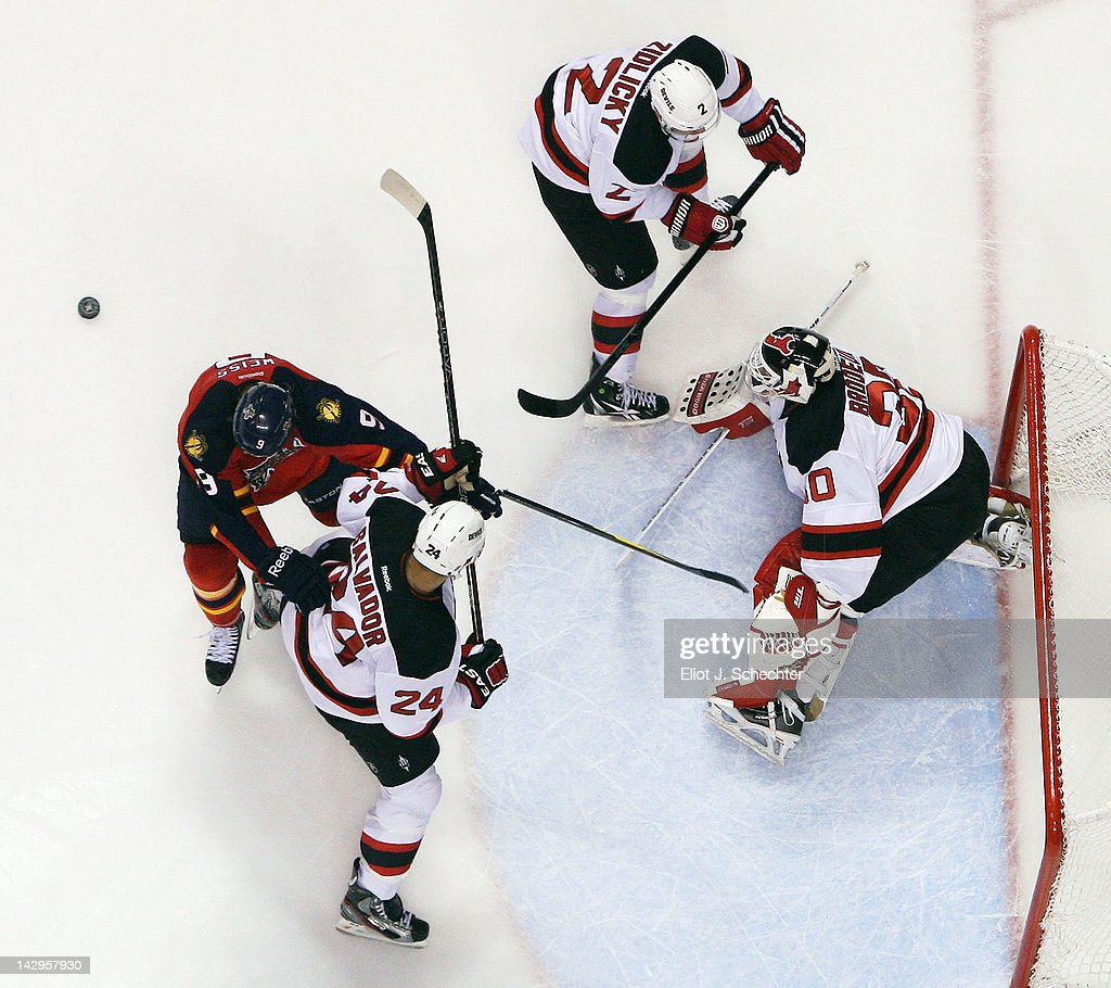 Goaltender <a gi-track='captionPersonalityLinkClicked' href=/galleries/search?phrase=Martin+Brodeur&family=editorial&specificpeople=201594 ng-click='$event.stopPropagation()'>Martin Brodeur</a> #30 of the New Jersey Devils defends the net with the help of teammates against Stephen Weiss #9 of the Florida Panthers in Game Two of the Eastern Conference Quarterfinals during the 2012 NHL Stanley Cup Playoffs at the BankAtlantic Center on April 15, 2012 in Sunrise, Florida.