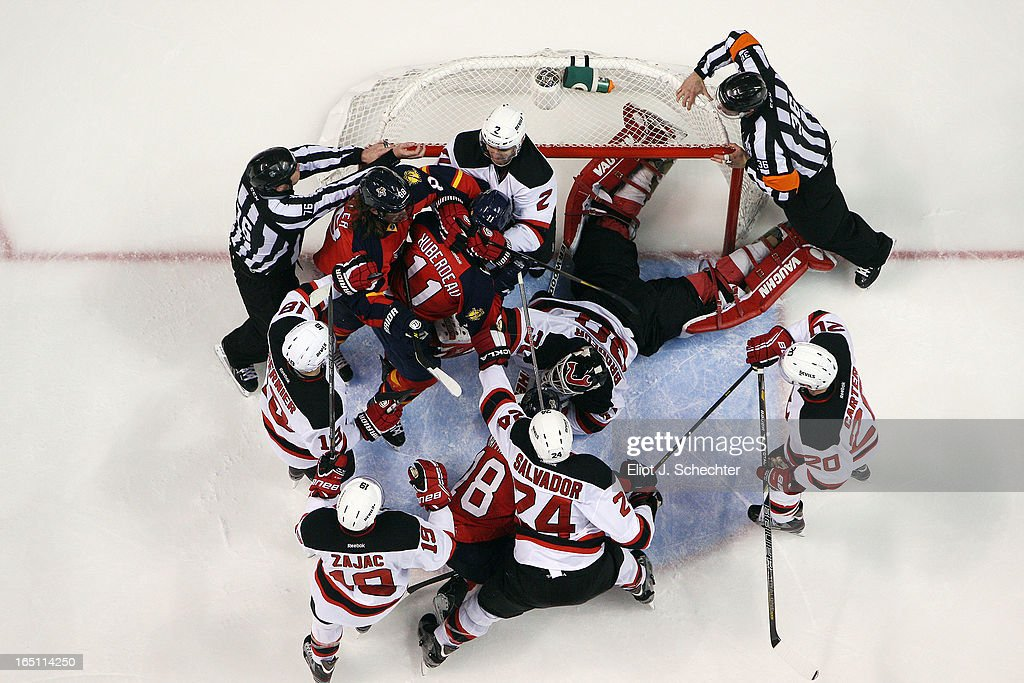 Goaltender <a gi-track='captionPersonalityLinkClicked' href=/galleries/search?phrase=Martin+Brodeur&family=editorial&specificpeople=201594 ng-click='$event.stopPropagation()'>Martin Brodeur</a> #30 of the New Jersey Devils lies on the ice while teammates push and shove the Florida Panthers for the win at the BB&T Center on March 30, 2013 in Sunrise, Florida.