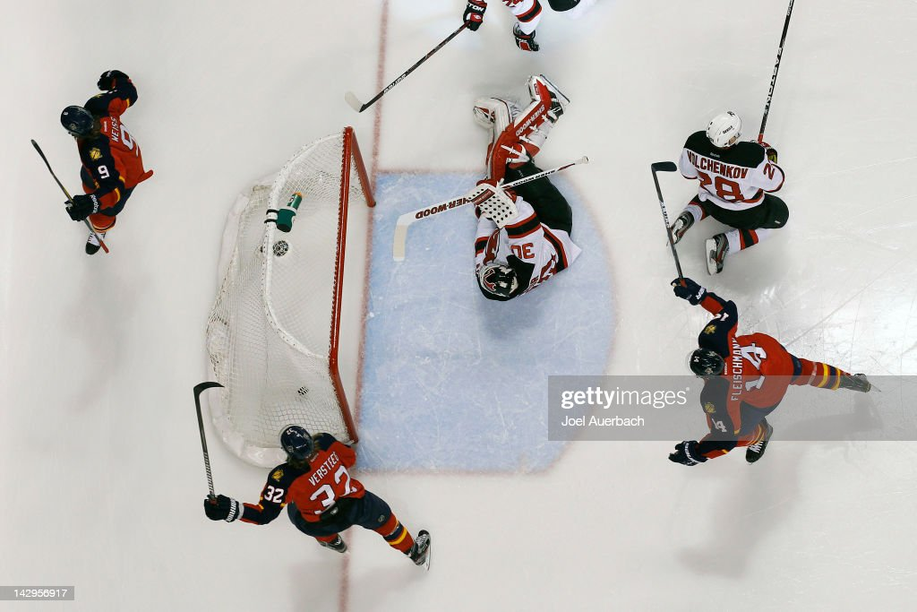 Goaltender <a gi-track='captionPersonalityLinkClicked' href=/galleries/search?phrase=Martin+Brodeur&family=editorial&specificpeople=201594 ng-click='$event.stopPropagation()'>Martin Brodeur</a> #30 of the New Jersey Devils looks back at the puck in the net as Stephen Weiss #9 scores and <a gi-track='captionPersonalityLinkClicked' href=/galleries/search?phrase=Kris+Versteeg&family=editorial&specificpeople=2242969 ng-click='$event.stopPropagation()'>Kris Versteeg</a> #32 and <a gi-track='captionPersonalityLinkClicked' href=/galleries/search?phrase=Tomas+Fleischmann&family=editorial&specificpeople=554398 ng-click='$event.stopPropagation()'>Tomas Fleischmann</a> #14 of the Florida Panthers start to celebrate in Game Two of the Eastern Conference Quarterfinals during the 2012 NHL Stanley Cup Playoffs at the BankAtlantic Center on April 15, 2012 in Sunrise, Florida. The Panthers defeated the Devils 4-2.