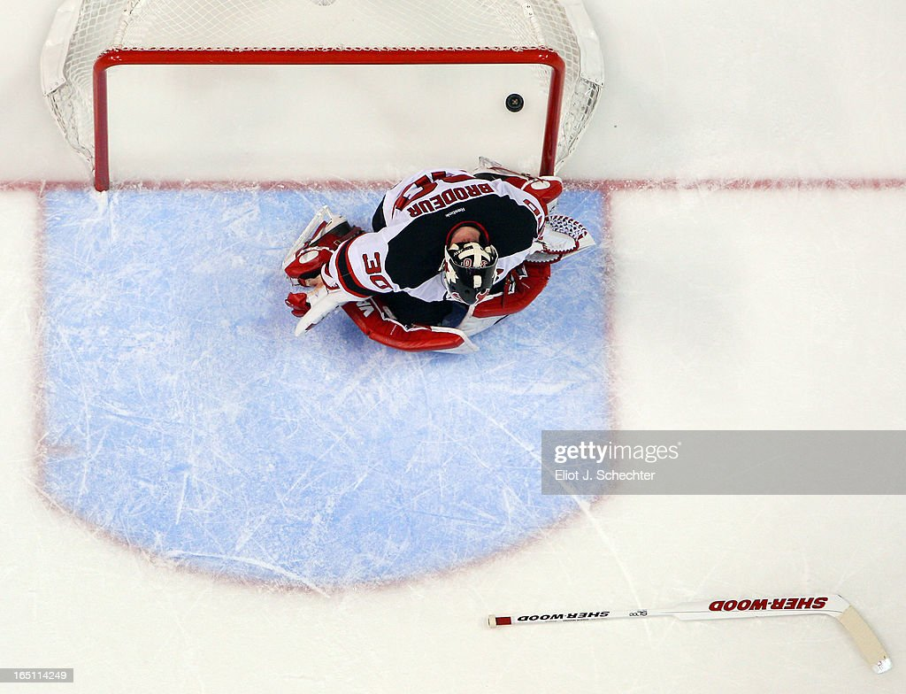 Goaltender <a gi-track='captionPersonalityLinkClicked' href=/galleries/search?phrase=Martin+Brodeur&family=editorial&specificpeople=201594 ng-click='$event.stopPropagation()'>Martin Brodeur</a> #30 of the New Jersey Devils sits in front of the net after a overtime goal by Dmitry Kulikov #7 of the Florida Panthers for the win at the BB&T Center on March 30, 2013 in Sunrise, Florida.