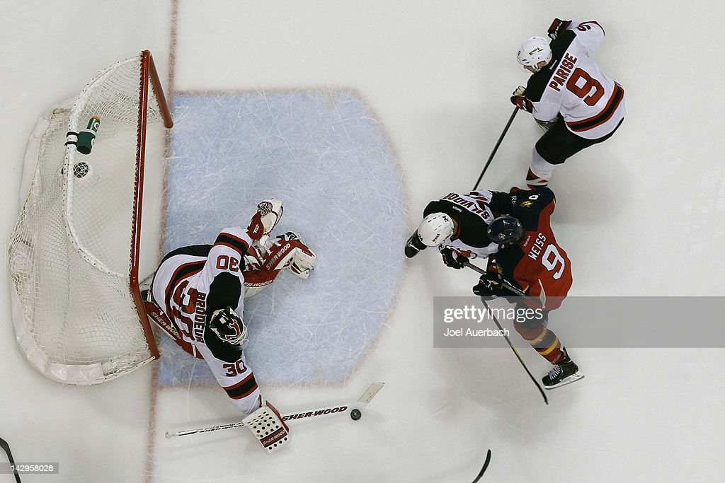 Goaltender <a gi-track='captionPersonalityLinkClicked' href=/galleries/search?phrase=Martin+Brodeur&family=editorial&specificpeople=201594 ng-click='$event.stopPropagation()'>Martin Brodeur</a> #30 of the New Jersey Devils stops a shot by Stephen Weiss #9 of the Florida Panthers in Game Two of the Eastern Conference Quarterfinals during the 2012 NHL Stanley Cup Playoffs at the BankAtlantic Center on April 15, 2012 in Sunrise, Florida. The Panthers defeated the Devils 4-2.