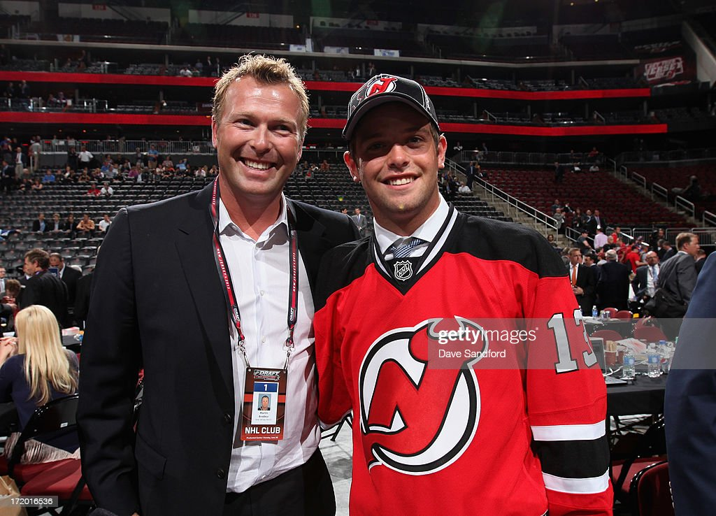 Goaltender <a gi-track='captionPersonalityLinkClicked' href=/galleries/search?phrase=Martin+Brodeur&family=editorial&specificpeople=201594 ng-click='$event.stopPropagation()'>Martin Brodeur</a> of the New Jersey poses with his son Anthony after selecting him 208th overall by the Devils during the 2013 NHL Draft at Prudential Center on June 30, 2013 in Newark, New Jersey.