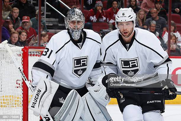Goaltender Martin Jones and Jamie McBain of the Los Angeles Kings in action during the NHL game against the Arizona Coyotes at Gila River Arena on...