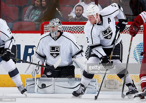 Goaltender Martin Jones of the Los Angeles Kings makes a pad save on the shot from the Arizona Coyotes during the third period of the NHL game at...