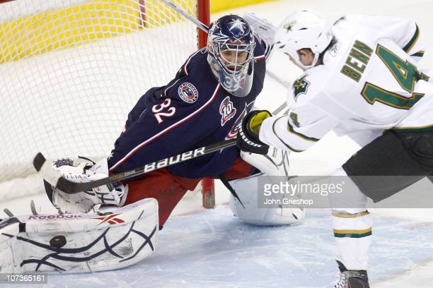 Goaltender Mathieu Garon of the Columbus Blue Jackets blocks a shot from Jamie Benn of the Dallas Stars in a shootout sealing a victory for Columbus...