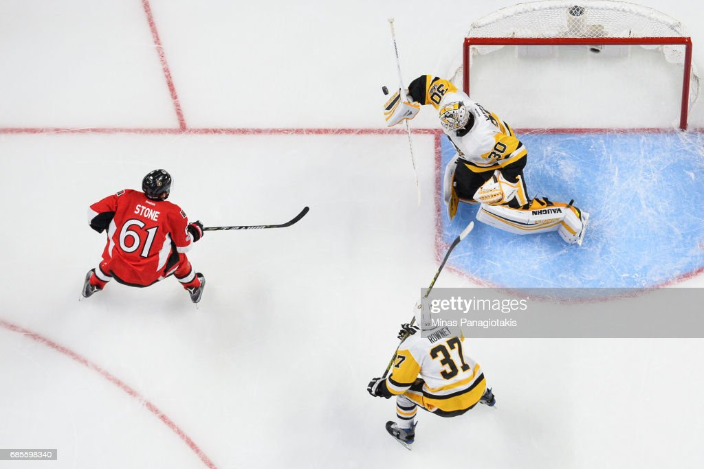 Goaltender Matt Murray #30 makes a blocker save on Mark Stone #61 of the Ottawa Senators as Carter Rowney #37 of the Pittsburgh Penguins skates towards the net in Game Four of the Eastern Conference Final during the 2017 NHL Stanley Cup Playoffs at Canadian Tire Centre on May 19, 2017 in Ottawa, Ontario, Canada. The Pittsburgh Penguins defeated the Ottawa Senators 3-2.