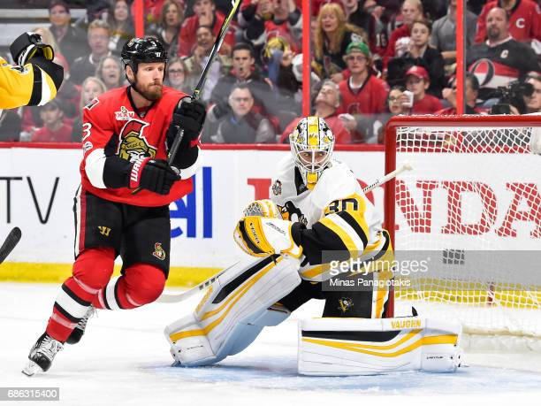 Goaltender Matt Murray of the Pittsburgh Penguins gets back into position as Marc Methot of the Ottawa Senators skates by in Game Four of the Eastern...
