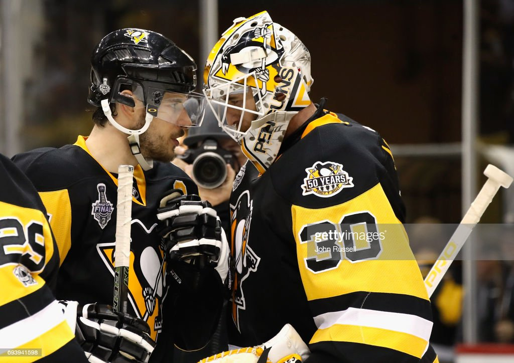 Goaltender Matt Murray #30 of the Pittsburgh Penguins is congratulated by teammate Sidney Crosby #87 after their 6-0 victory over the Nashville Predators in Game Five of the 2017 NHL Stanley Cup Final at PPG Paints Arena on June 8, 2017 in Pittsburgh, Pennslyvannia. The Penguins lead the series 3-2.
