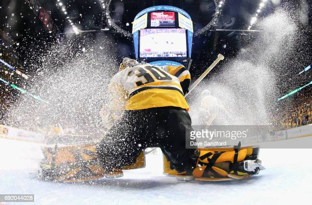 Goaltender Matt Murray of the Pittsburgh Penguins makes a save as ice sprays during the second period of Game Three of the 2017 NHL Stanley Cup Final...