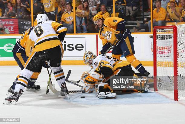 Goaltender Matt Murray of the Pittsburgh Penguins makes a save as Filip Forsberg of the Nashville Predators looks for the rebound in the third period...