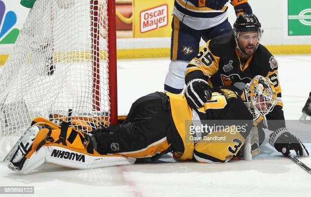 Goaltender Matt Murray of the Pittsburgh Penguins reacts after making a save with teammate Ron Hainsey during the first period of Game One of the...