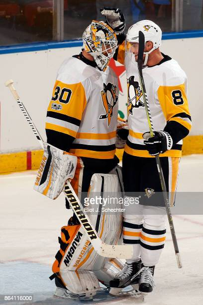 Goaltender Matthew Murray of the Pittsburg Penguins celebrates with teammate Brian Dumoulin their win against the Florida Panthers at the BBT Center...