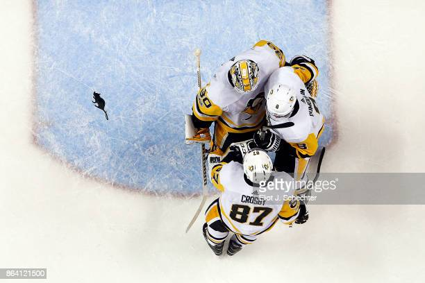 Goaltender Matthew Murray of the Pittsburg Penguins celebrates with teammates Sidney Crosby and Brian Dumoulin their win against the Florida Panthers...
