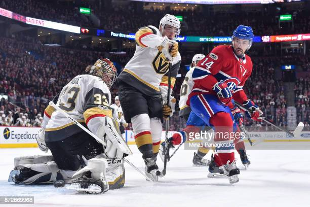 Goaltender Maxime Lagace makes a save near teammate Brad Hunt of the Vegas Golden Knights and Tomas Plekanec of the Montreal Canadiens during the NHL...