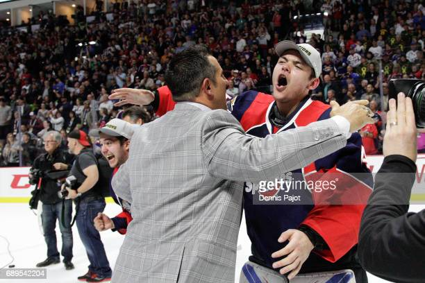 Goaltender Michael DiPietro of the Windsor Spitfires celebrates with Bob Boughner after winning the championship game of the Mastercard Memorial Cup...
