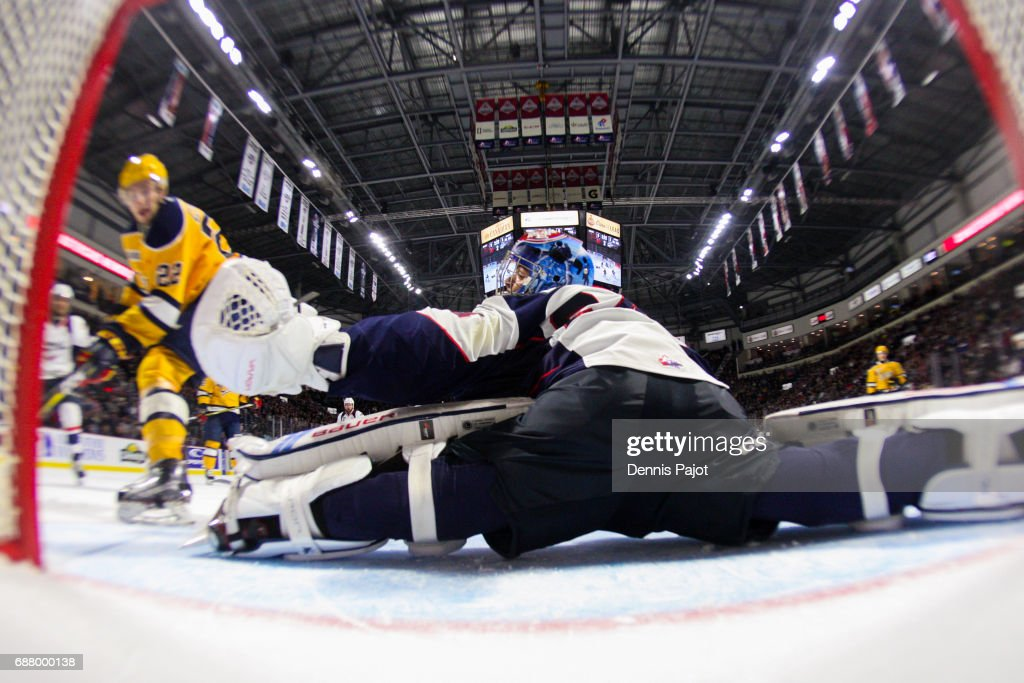 Goaltender Michael DiPietro #64 of the Windsor Spitfires defends makes a glove save against forward Anthony Cirelli #22 of the Erie Otters on May 24, 2017 during Game 6 of the Mastercard Memorial Cup at the WFCU Centre in Windsor, Ontario, Canada.