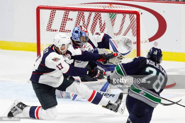 Goaltender Michael DiPietro of the Windsor Spitfires makes a save against forward Keegan Kolesar of the Seattle Thunderbirds on May 21 2017 during...