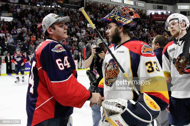 Goaltender Michael DiPietro of the Windsor Spitfires shakes hands with Troy Timpano after winning the championship game of the Mastercard Memorial...