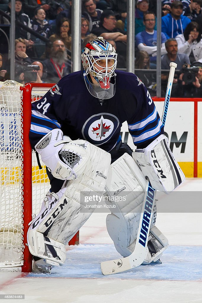 Goaltender Michael Hutchinson #34 of the Winnipeg Jets defends the net during his NHL debut against the Minnesota Wild at the MTS Centre on April 7, 2014 in Winnipeg, Manitoba, Canada. The Wild defeated the Jets 1-0.