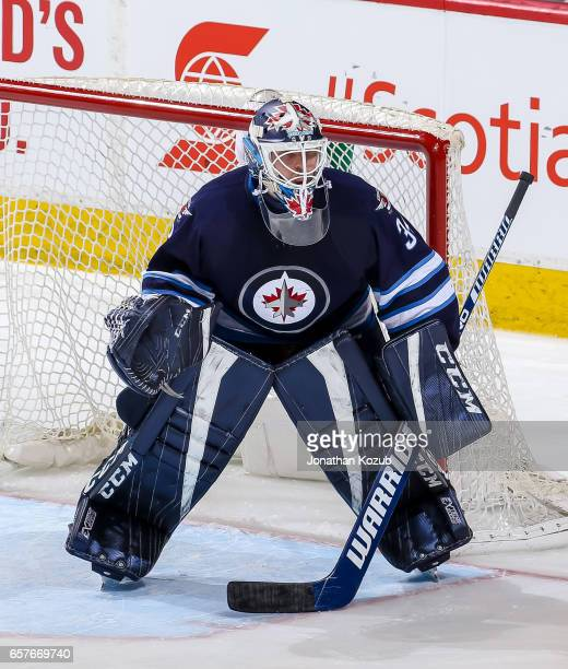 Goaltender Michael Hutchinson of the Winnipeg Jets guards the net during third period action against the Philadelphia Flyers at the MTS Centre on...