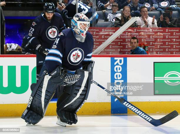 Goaltender Michael Hutchinson of the Winnipeg Jets hits the ice prior to puck drop against the Vancouver Canucks at the MTS Centre on March 26 2017...