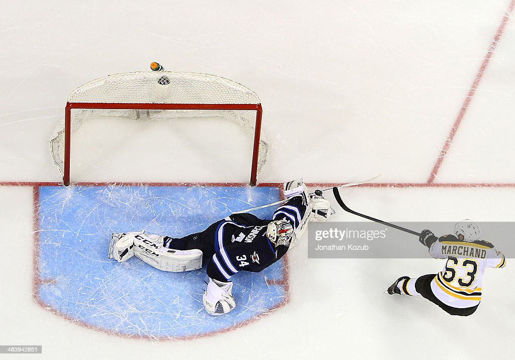 Goaltender Michael Hutchinson #34 of the Winnipeg Jets stretches in the crease to make a save on <a gi-track='captionPersonalityLinkClicked' href=/galleries/search?phrase=Brad+Marchand&family=editorial&specificpeople=2282544 ng-click='$event.stopPropagation()'>Brad Marchand</a> #63 of the Boston Bruins during the shootout at the MTS Centre on April 10, 2014 in Winnipeg, Manitoba, Canada. The Jets defeated the Bruins 2-1.