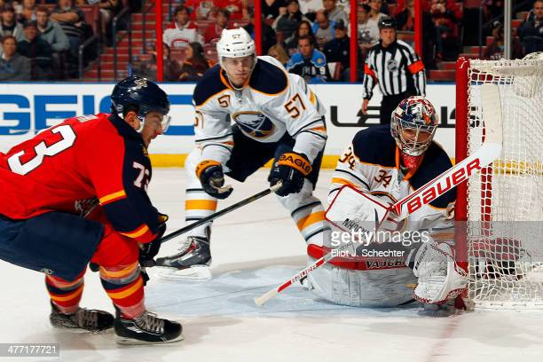 Goaltender Michal Neuvirth of the Buffalo Sabres defends the net against Brandon Pirri of the Florida Panthers at the BBT Center on March 7 2014 in...