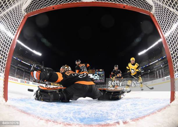 Goaltender Michal Neuvirth of the Philadelphia Flyers can't make the glove save on a shot for a goal by Sidney Crosby of the Pittsburgh Penguin not...