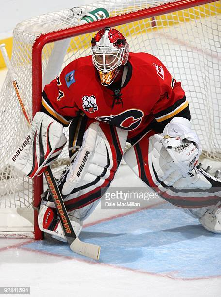 Goaltender Miikka Kiprusoff of the Calgary Flames defends his net against the Colorado Avalanche on October 28 2009 at the Pengrowth Saddledome in...