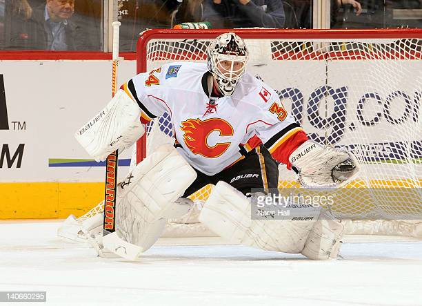 Goaltender Miikka Kiprusoff of the Calgary Flames makes a glove save against the Phoenix Coyotes at Jobingcom Arena on March 1 2012 in Glendale...