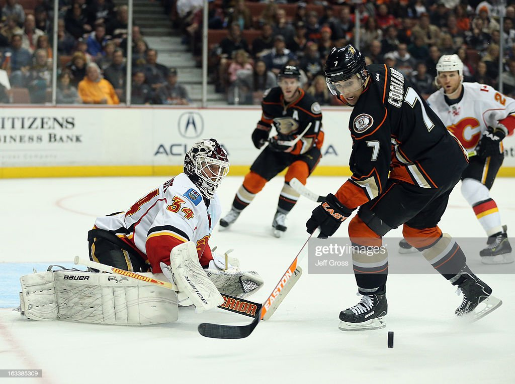 Goaltender <a gi-track='captionPersonalityLinkClicked' href=/galleries/search?phrase=Miikka+Kiprusoff&family=editorial&specificpeople=171703 ng-click='$event.stopPropagation()'>Miikka Kiprusoff</a> #34 of the Calgary Flames makes a save, as <a gi-track='captionPersonalityLinkClicked' href=/galleries/search?phrase=Andrew+Cogliano&family=editorial&specificpeople=869296 ng-click='$event.stopPropagation()'>Andrew Cogliano</a> #7 of the Anaheim Ducks pursues in the third period at Honda Center on March 8, 2013 in Anaheim, California. The Ducks defeated the Flames 4-0.