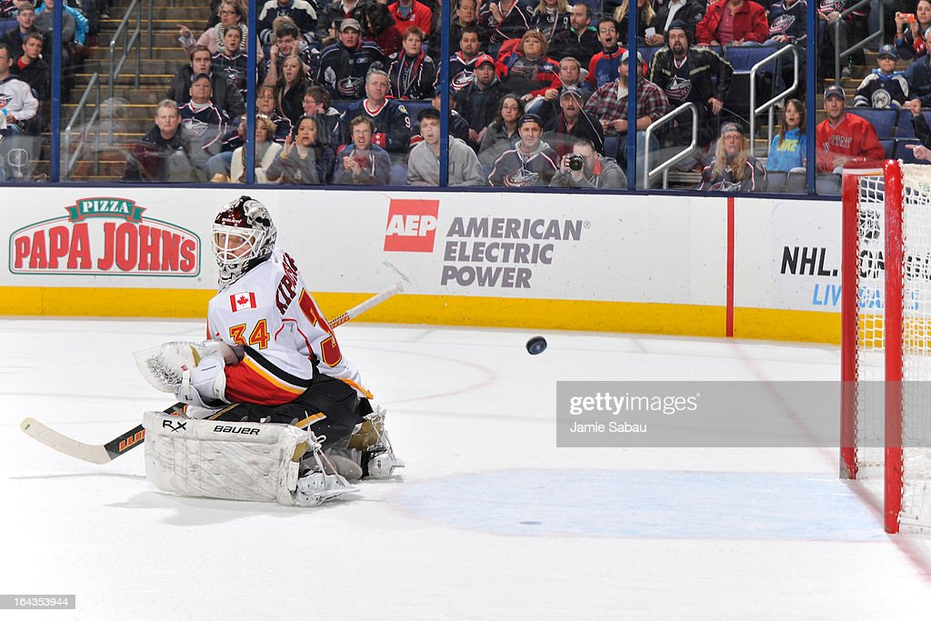 Goaltender Miikka Kiprusoff #34 of the Calgary Flames watches as a puck goes into the net off a shot by Colton Gillies #9 of the Columbus Blue Jackets during the third period on March 22, 2013 at Nationwide Arena in Columbus, Ohio. Columbus defeated Calgary 5-1.