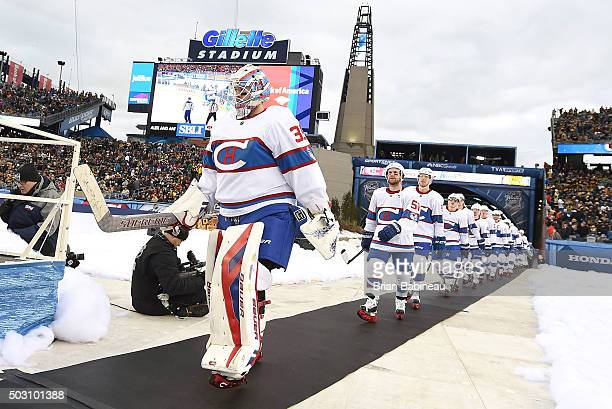 Goaltender Mike Condon of the Montreal Canadiens and his teammates make their way to the ice for the second period of the 2016 Bridgestone NHL...