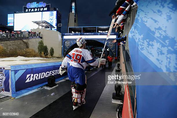 Goaltender Mike Condon of the Montreal Canadiens gives his stick to a fan as he leaves the field after his team defeated the Boston Bruins 51 in the...