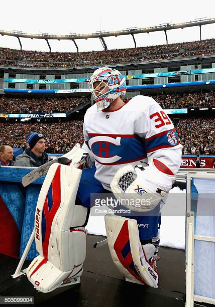 Goaltender Mike Condon of the Montreal Canadiens leaves the ice after warm ups before the start of the 2016 Bridgestone NHL Classic against the...