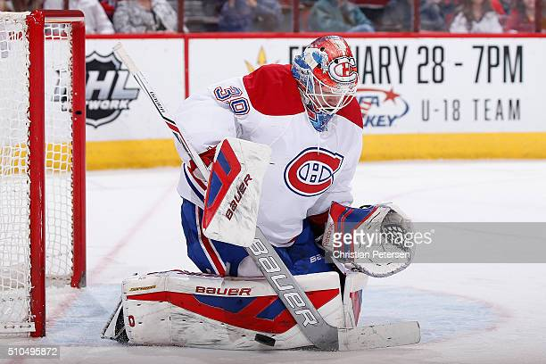 Goaltender Mike Condon of the Montreal Canadiens makes a pad save on a shot from the Arizona Coyotes during the first period of the NHL game at Gila...