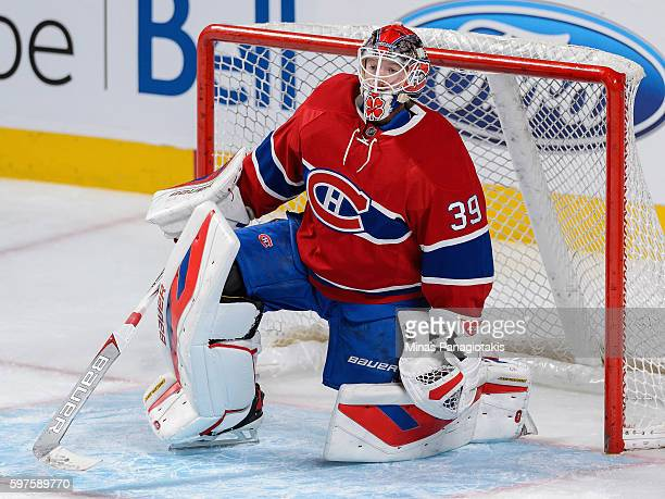 Goaltender Mike Condon of the Montreal Canadiens plays in the game against the Detroit Red Wings at Bell Centre on October 17 2015 in Montreal Quebec...